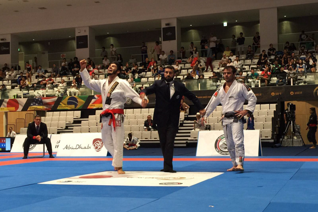 Roberto Satoshi celebrates his win over Celso Venícius in the 77kg division final