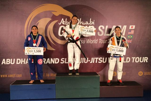 Marina Ribeiro at the top of the female black/brown belt open class podium