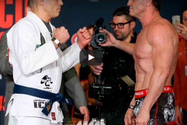 Royce Gracie steps on the scale before fight with Shamrock wearing a blue belt like his father Helio