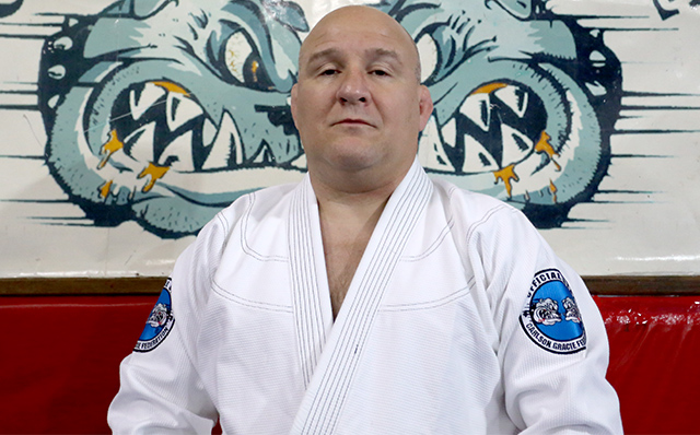 Learn the classic clock choke from Carlson Gracie Jr.