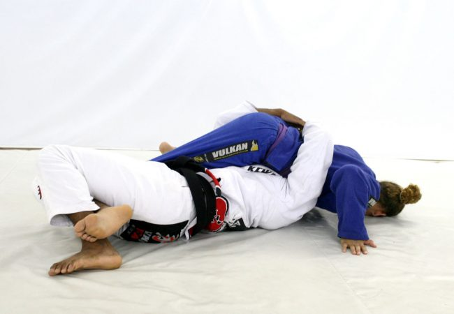 Learn from Serginho Moraes how to apply a leg lock from deep half-guard