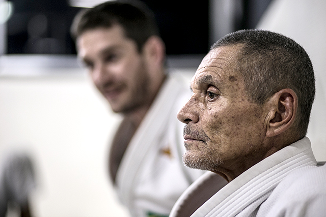 Relson Gracie talks about his father Helio and teaches a defense against side control moving to an armbar
