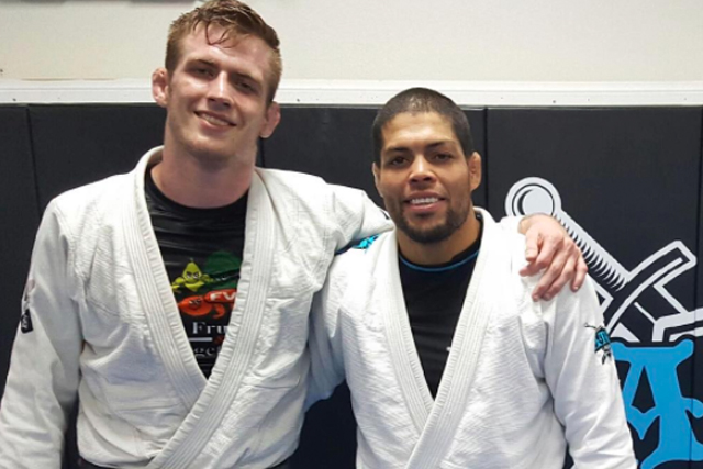 Keenan Cornelius gets from André Galvão first degree on black belt