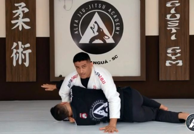Overcome the armbar defense with a transition to the back, with Marcos Giusti